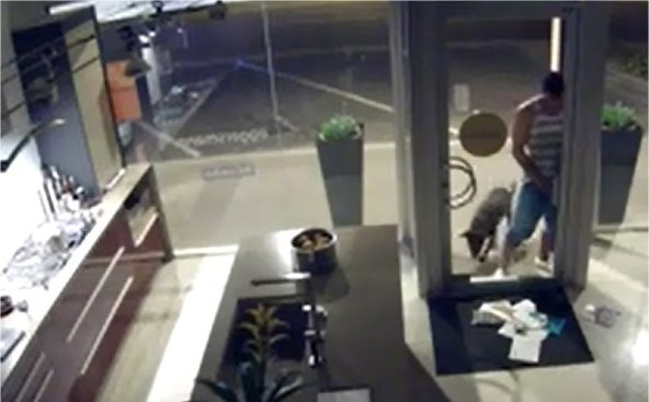 Video: Man Caught On Video Urinating Through Mail Slot of Scottsdale Shop
